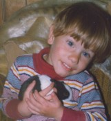 Jay holding baby Dutch rabbit 1978